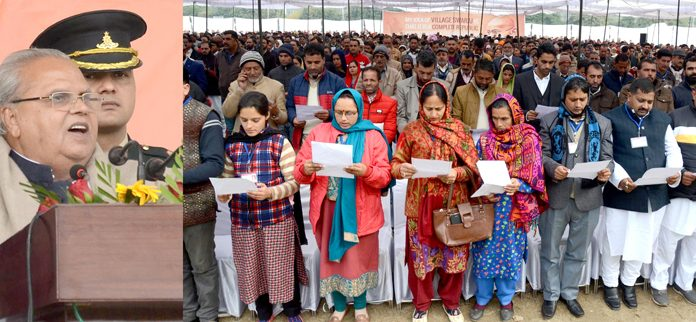 Governor Satya Pal Malik addressing the Sarpanchs in Jammu on Friday. -Excelsior/Rakesh