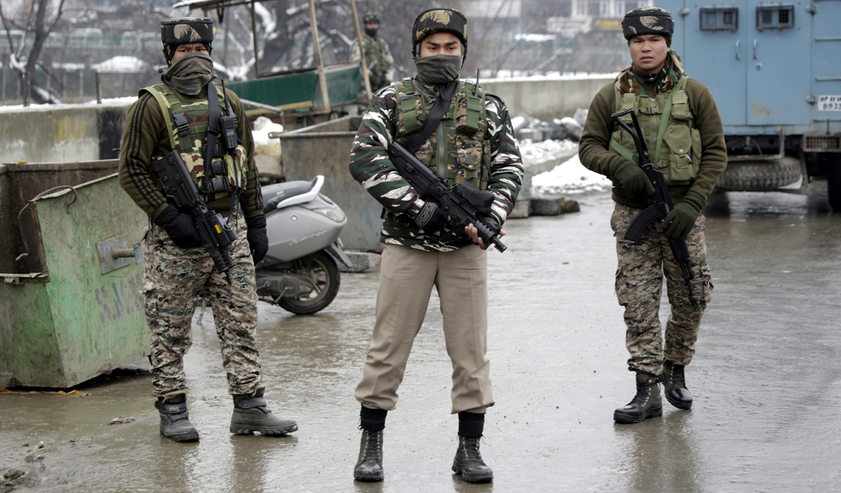 Security personnel on high alert after grenade attack at Zero Bridge in Srinagar on Thursday. -Excelsior/Shakeel