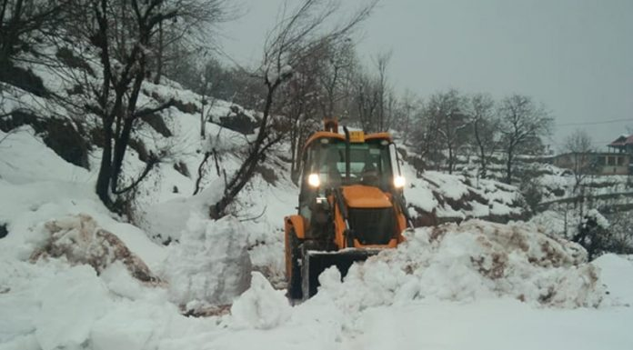 Snow clearance work in progress at Banihal on Wednesday.