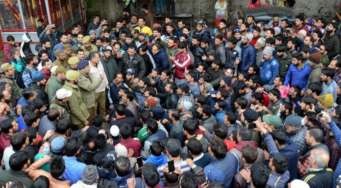 Stranded Kashmiri passengers staging protest at Bus Stand, Jammu on Friday. —Excelsior/Rakesh