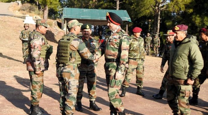 Northern Command chief Lt Gen Ranbir Singh interacting with soldiers during visit to LoC on Monday.