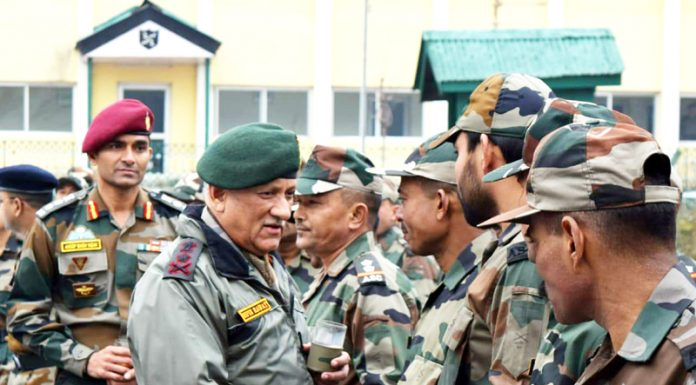 Army chief Gen Bipin Rawat inter-acting with troops on LoC in Kupwara on Tuesday.