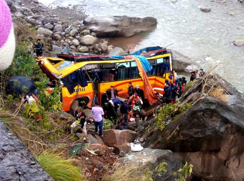 Rescue teams near wreckage of passenger bus, which fell into deep gorge near Udhampur on Thursday.