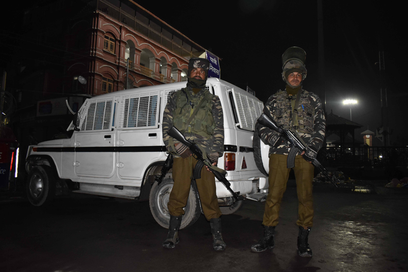 Security forces alert outside a CRPF installation after militants hurled grenade at Lal Chowk in Srinagar. -Excelsior/Shakeel