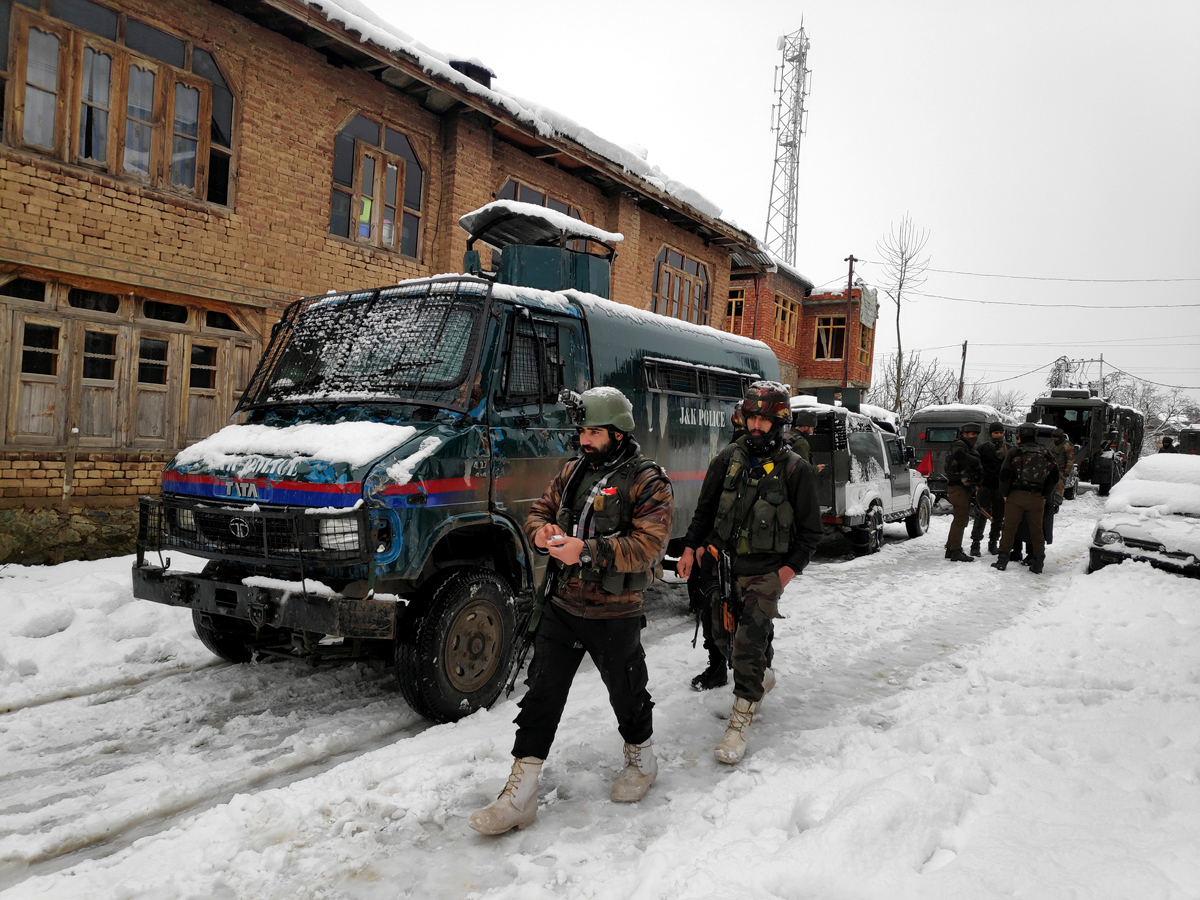 Security forces during search operation at Hapatnar in Budgam on Monday. -Excelsior/Shakeel