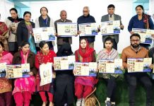 Students alongwith dignitaries displaying Brochure of Vishwa Bharati College of Education.
