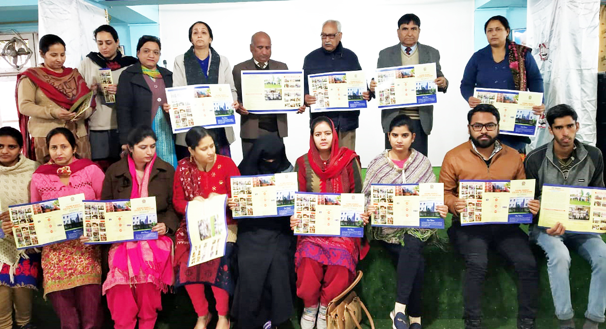 Students alongwith dignitaries displaying Brochure of Vishwa Bharati College of Education.