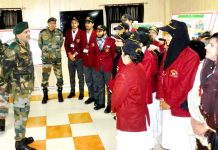 A senior Army officer interacting with students during the flagged in ceremony of capacity building tour in Poonch district.
