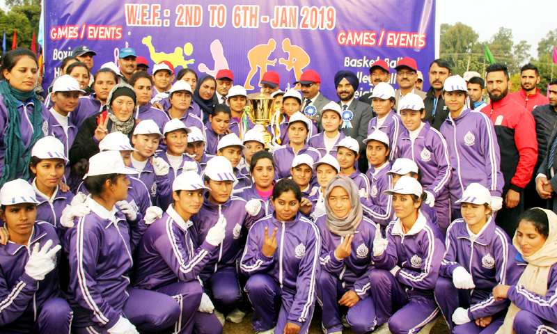 Contingent of female sports persons posing alongwith Chief Secretary BVR Subramanyam during concluding ceremony of Inter Zone Sports meet in Jammu on Sunday.