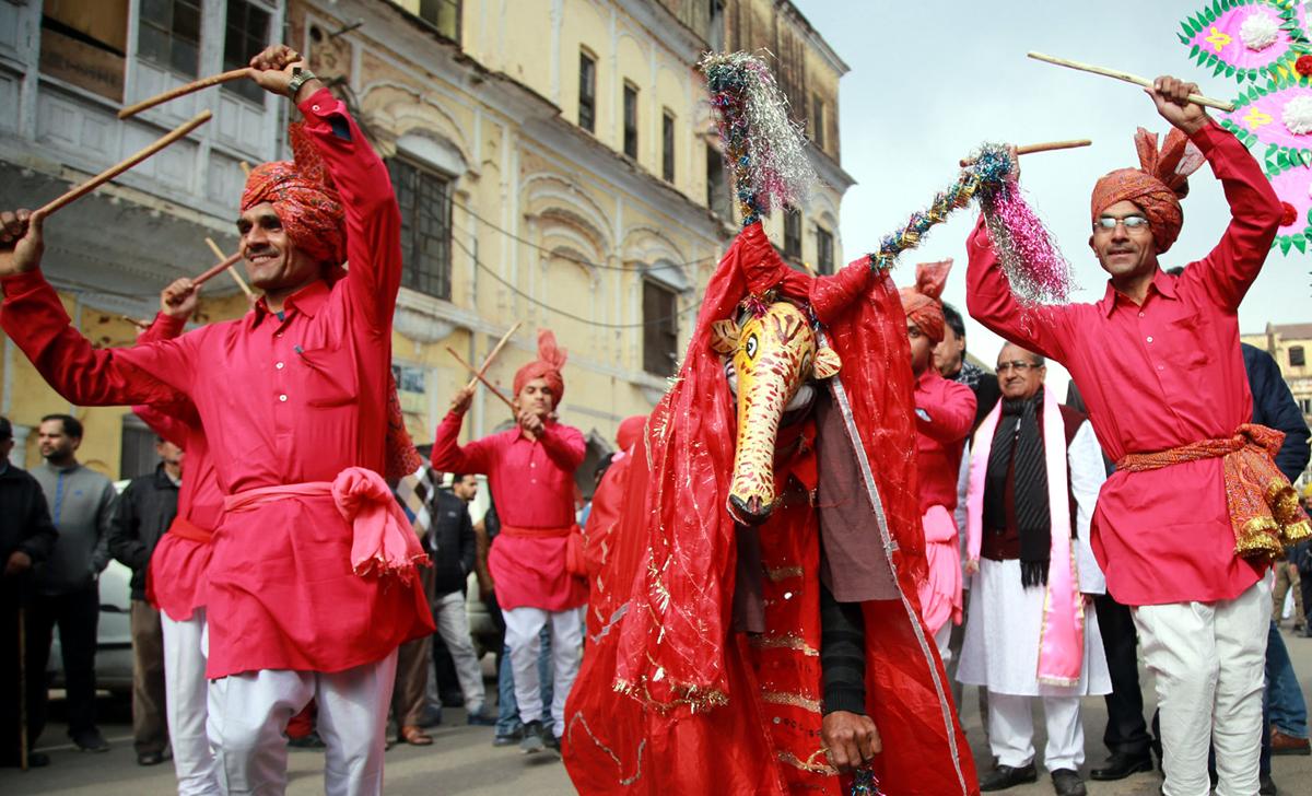 Nat Manch artists performing Dhandiya during Lohri procession in Jammu. -Excelsior/Rakesh