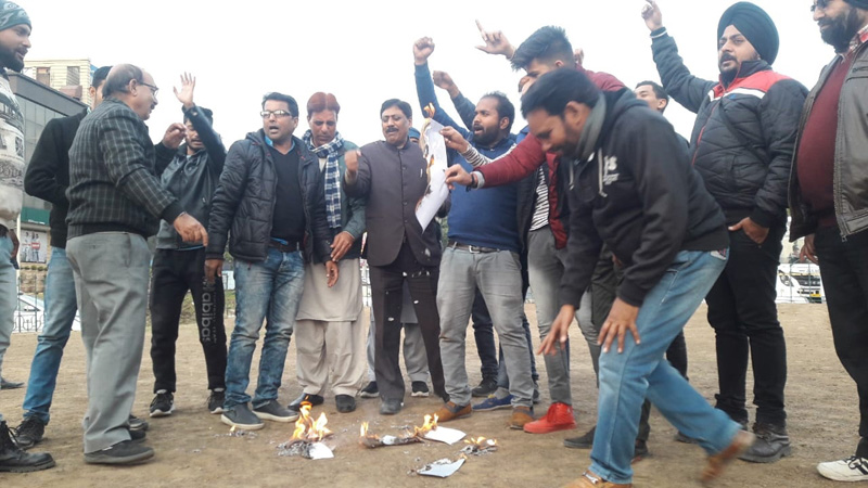 Members of Confederation raising slogans during protest at Jammu on Friday.