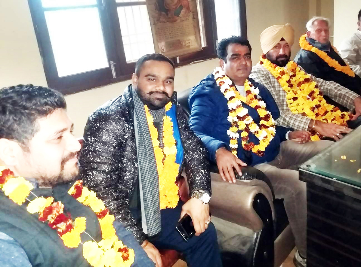 Newly elected Vegetable and Fruit Association Subzi Mandi Narwal team posing for a photograph at Jammu on Saturday.