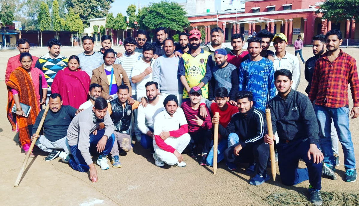 Winners of exhibition Cricket match posing along with dignitaries and officials at Akhnoor.