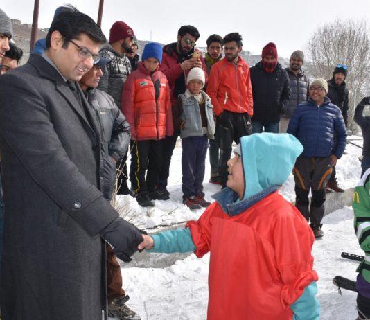 Deputy Commissioner and CEO, LAHDC, Kargil Vikas Kundal interacting with kids during Ice Hockey Camp in Kargil. — Excelsior/Basharat Ladakhi