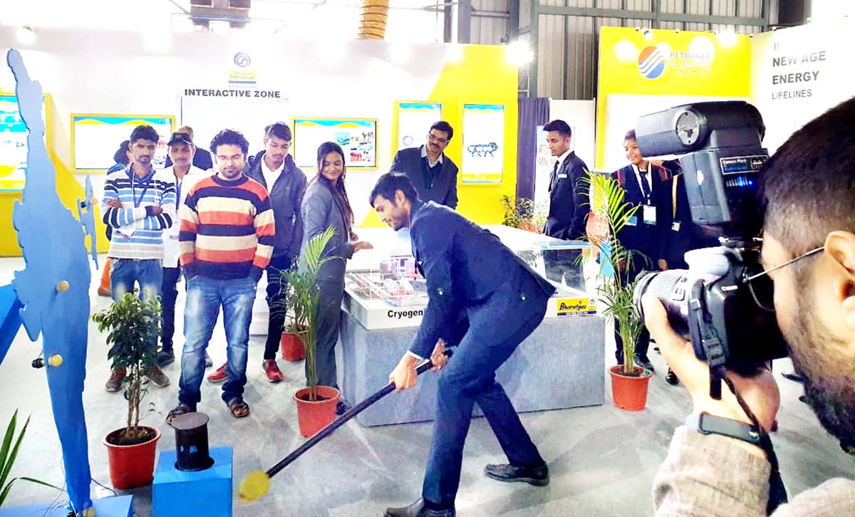 Visitors taking part in 'strike the hammer' during trade show.