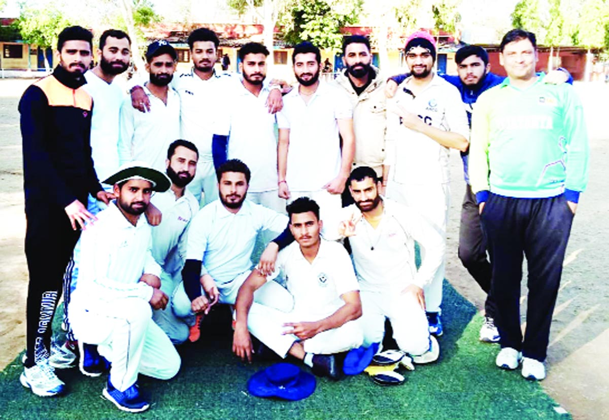 Winners posing along with officials during a match of New Year Cricket Cup 2019 Akhnoor on Monday.