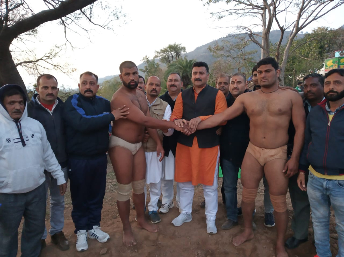 Wrestlers posing along with the chief guest and other dignitaries at Jindrah in Jammu on Tuesday.