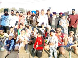 Young hockey players posing along with dignitaries and officials during concluding ceremony of Hockey Camp in Jammu.