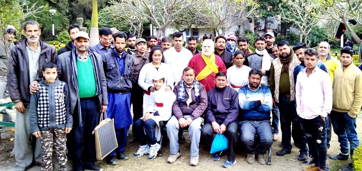 Artists of the play 'Hounsley Bluand Rakho' posing for a group photograph at Jammu on Monday.