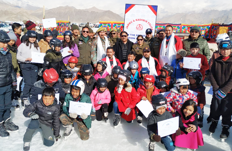 Budding skaters posing along with dignitaries and officials during concluding ceremony during Ice Skating Training Camp in Leh. —Excelsior/Morup Stanzin