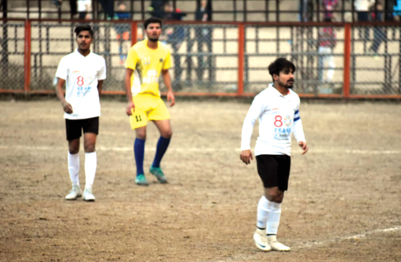 Footballers in action during a match of 12th Christmas Gold Cup Football Tournament in Jammu.
