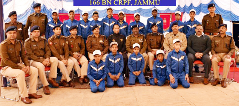 Children posing along with DIG CRPF and other dignitaries before leaving foir Bharat Darshan tour.