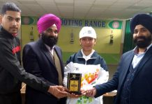 Rupali Katal with Er Nirmaljit Singh, President of KPS Shooting Club posing for photograph.