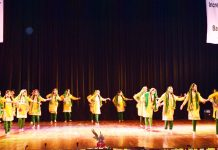 Students presenting cultural item while celebrating Annual Day at General Zorawar Singh Auditorium in Jammu.