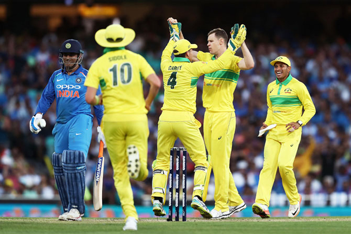 Australian players celebrating dismissal of M S Dhoni during Ist ODI at Sydney on Saturday.