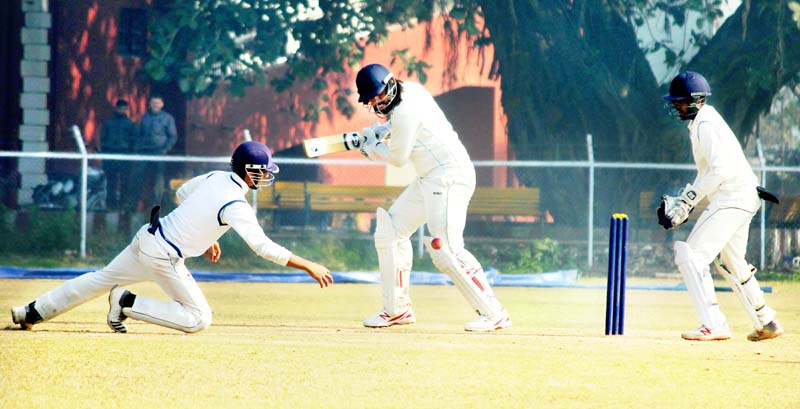 Batsman executing a slog sweep during a Ranji Trophy match between J&K and Jharkhand in Jammu on Thursday. -Excelsior/Rakesh