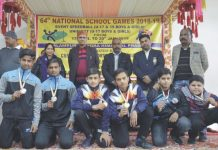 Speed Ball medal winners posing along with dignitaries and officials in Himachal Pradesh.