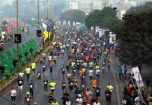 Runners sweating-it-out during Tata Mumbai Marathon.