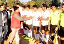 Dignitaries interacting with footballers during 12th Christmas Gold Cup Football Tournament at GGM Sciecne College ground on Thursday.
