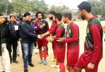 Dignitaries interacting with players during semifinal match of 12th Christmas Gold Cup Football Tournament in Jammu.