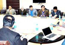 Advisor K K Sharma chairing a meeting on Monday.