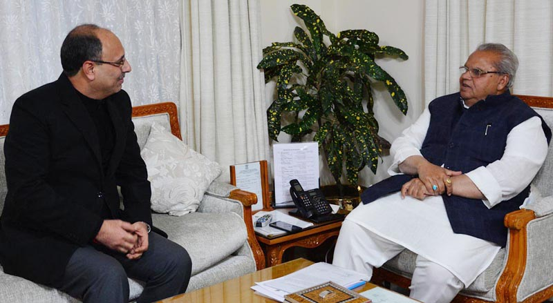 Governor Satya Pal Malik meeting Justice (retd) M K Hanjura on Friday.