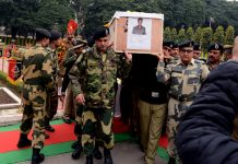 BSF officers carrying mortal remains of Assistant Commandant Vinay Prasad martyred along IB on Wednesday.