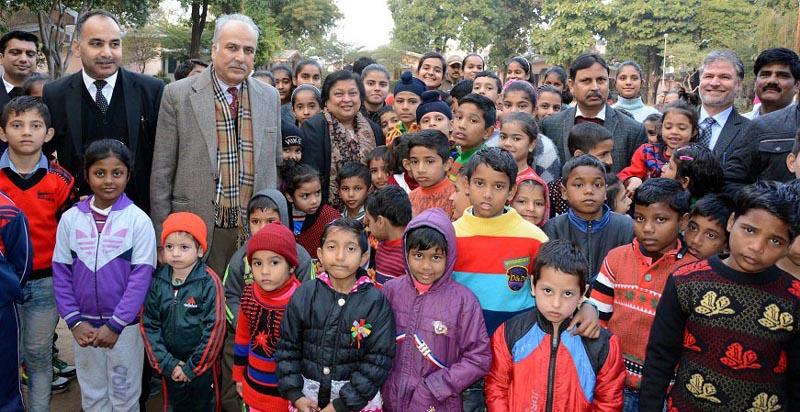 Chief Justice Gita Mittal with inmates of SOS Children's village.