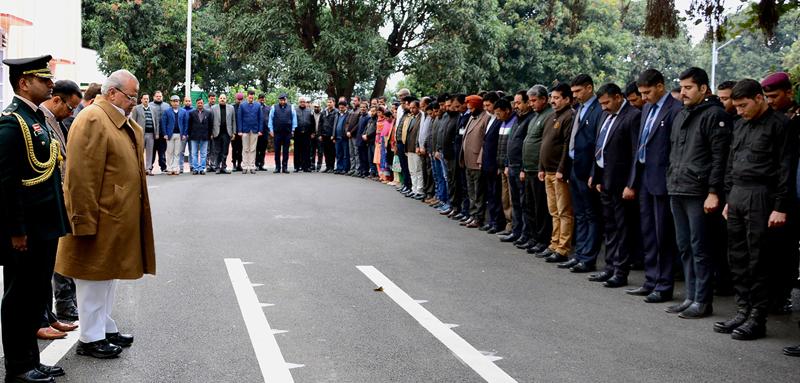 Governor Satya Pal Malik and Raj Bhawan staff paying tributes to martyrs of freedom struggle in Jammu on Wednesday.