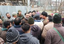 NC leader Salman Sagar interacting with locals at Hazaratbal in Srinagar on Sunday.