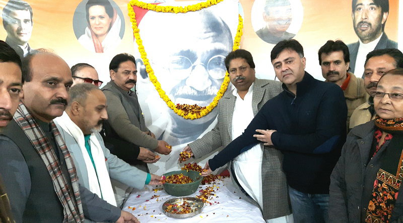 Senior Cong leaders Raman Bhalla, Manmohan Singh, Vikram Malhotra and others paying tributes to Mahatma Gandhi in a function held at PCC office in Jammu on Wednesday.