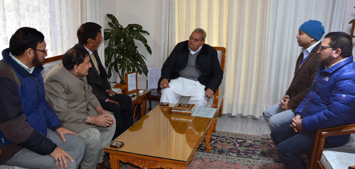 Governor Satya Pal Malik meeting a delegation led by Qamar Ali Akhoon on Wednesday.