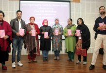 MIER Vice Chairperson and others releasing a booklet during workshop on Tuesday.