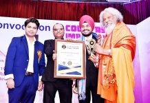 Dr HS Paul, Delhi Bureau Chief of Daily Excelsior, receiving award from MP, Dr (Prof) PK Patasani and Dr (Prof) Abhiram Kulshreshtha, MD, ACS Media Corporation.