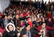 NHM employees staging protest at Exhibition Ground in Jammu. —Excelsior/Rakesh