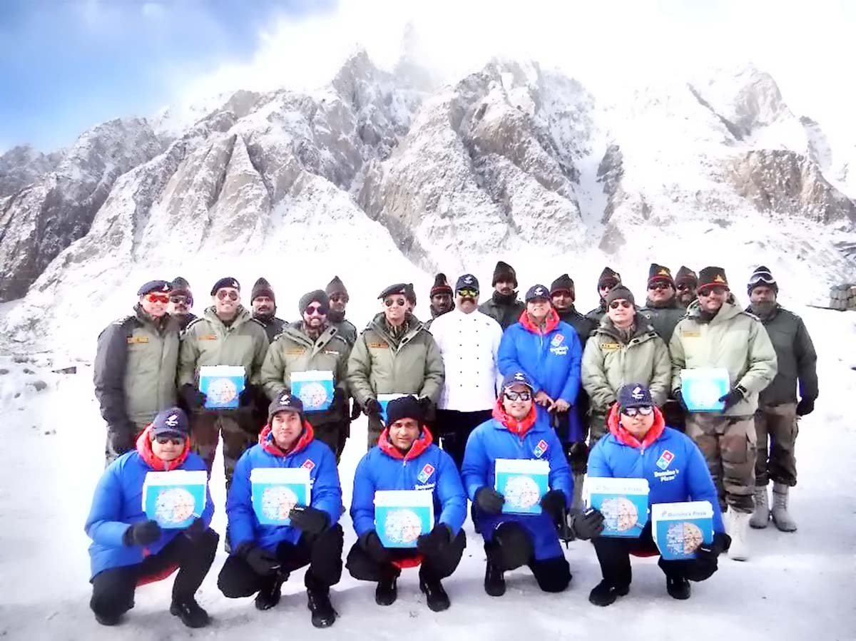 A team of Domino's with Army personnel at Siachen Glacier.
