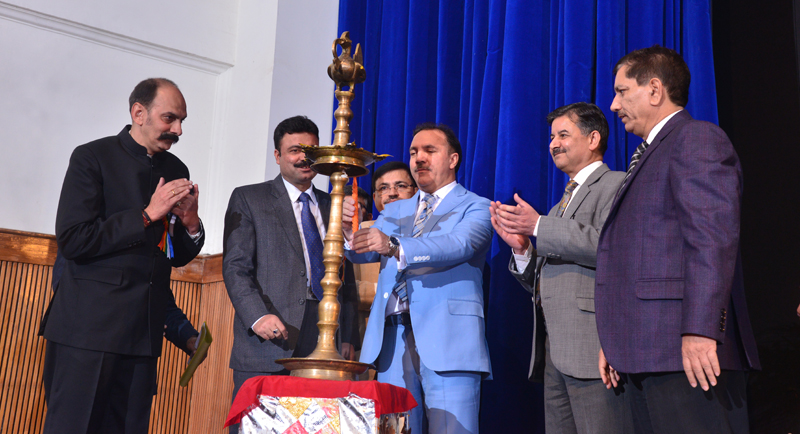 J&K Bank Chairman & CEO, Parvez Ahmed lighting the ceremonial lamp at a function in Jammu on Tuesday.