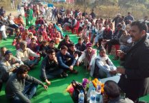 Former Minister Manohar Lal Sharma addressing a gathering during his visit in Billawar Constituency.