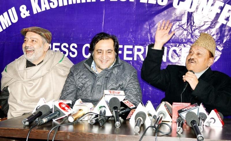 Former Congress leader Gani Vakil joining Peoples Conference in presence of Sajad Lone in Srinagar. -Excelsior/Shakeel