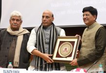 Union Minister for Railways and Coal, Piyush Goyal presenting the memento to the Union Home Minister, Rajnath Singh, at the Conference on Railway Security, in New Delhi on Wednesday.